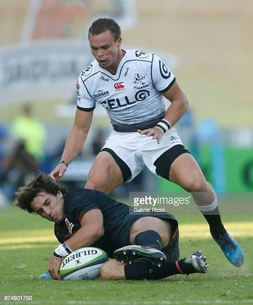 Bautista Ezcurra of Jaguares defends the ball from Curwin Bosch of Sharks during a match between Jaguares v Sharks as part of Super Rugby Rd 10 at...