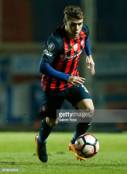Bautista Merlini of San Lorenzo drives the ball during a match between San Lorenzo and Universidad Catolica as part of Copa CONMEBOL Libertadores...