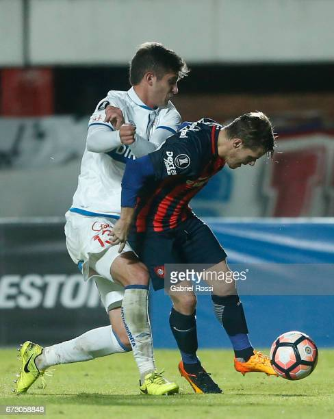 Bautista Merlini of San Lorenzo fights for the ball with Benjamin Kuscevic of Universidad Catolica during a match between San Lorenzo and Universidad...