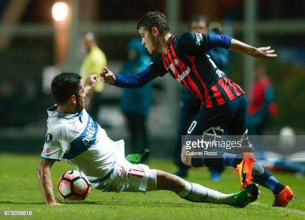 Bautista Merlini of San Lorenzo fights for the ball with Fernando Cordero of Universidad Catolica during a match between San Lorenzo and Universidad...