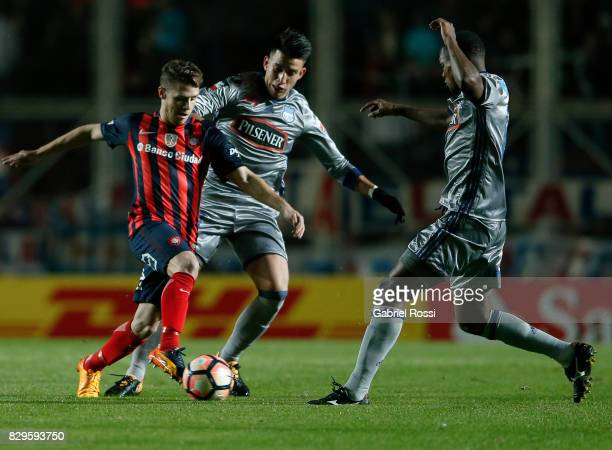Bautista Merlini of San Lorenzo fights for the ball with Fernando Gaibor of Emelec during a second leg match between San Lorenzo and Emelec as part...