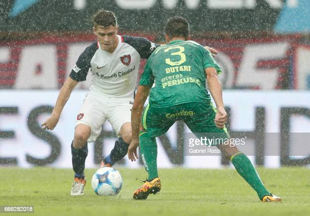 Bautista Merlini of San Lorenzo fights for the ball with Francisco Dutari of Sarmiento during a match between San Lorenzo and Sarmiento as part of...