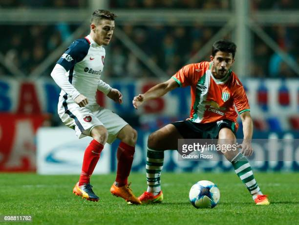 Bautista Merlini of San Lorenzo fights for the ball with Gonzalo Bettini of Banfield during a match between San Lorenzo and Banfield as part of...