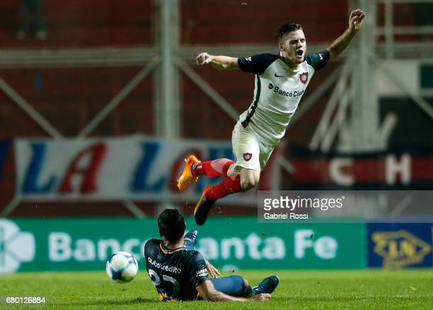 Bautista Merlini of San Lorenzo fights for the ball with Jose Leguizamon of Rosario Central during a match between San Lorenzo and Rosario Central as...