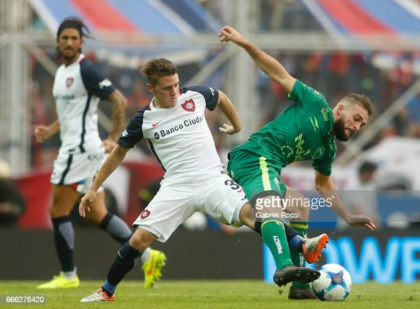 Bautista Merlini of San Lorenzo fights for the ball with Rodrigo Depetris of Sarmiento during a match between San Lorenzo and Sarmiento as part of...