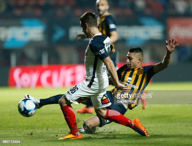 Bautista Merlini of San Lorenzo fights for the ball with Victor Salazar of Rosario Central during a match between San Lorenzo and Rosario Central as...