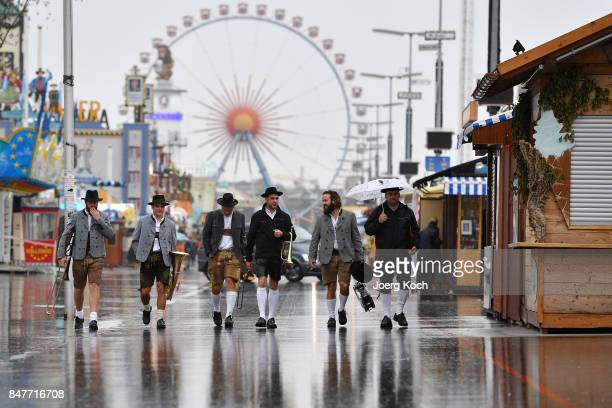 A bavarian brass band crosses the festival area on the first day of the 2017 Oktoberfest beer fest on September 16 2017 in Munich Germany Oktoberfest...