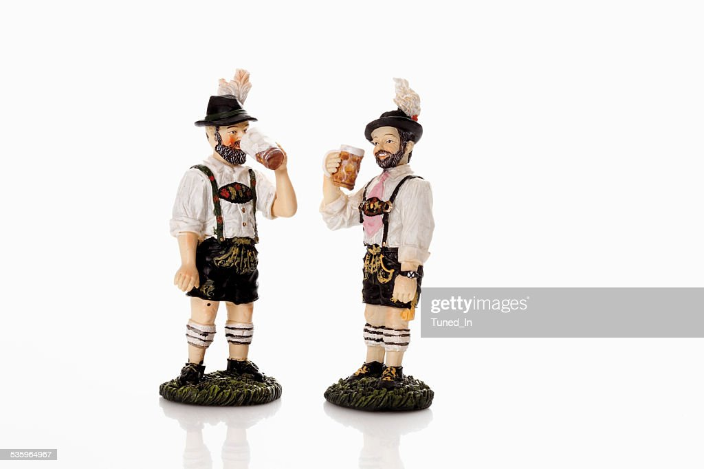 Bavarian figurines drinking beer from beer stein : Stock Photo