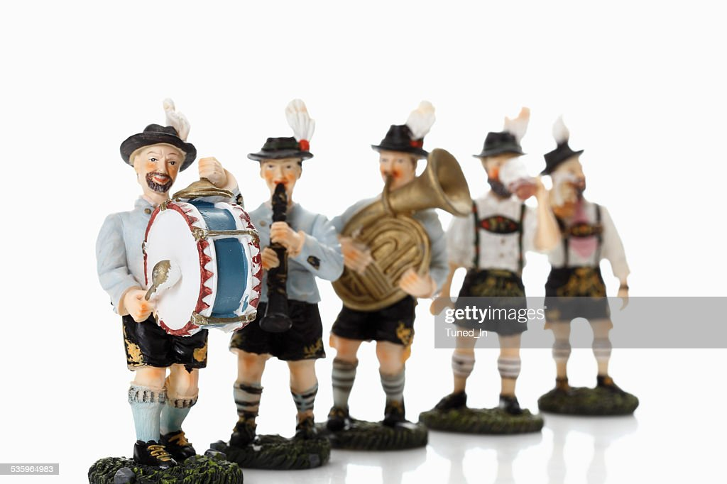 Bavarian figurines playing music on white background : Stock Photo