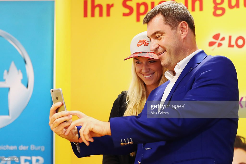 Bavarian Finance Minister Markus Soeder takes a selfie with Sabine Lisicki of Germany during the official draw ceremony on Day One of the Nuernberger...