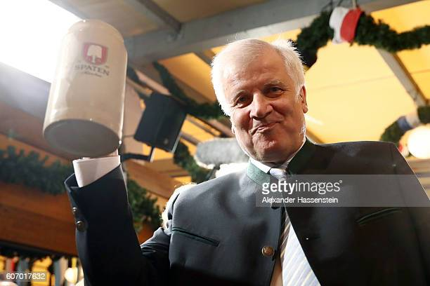 Bavarian MinisterPresident Horst Seehofer lifts up the first beer mug at the opening of the 2016 Oktoberfest beer festival at Theresienwiese on...