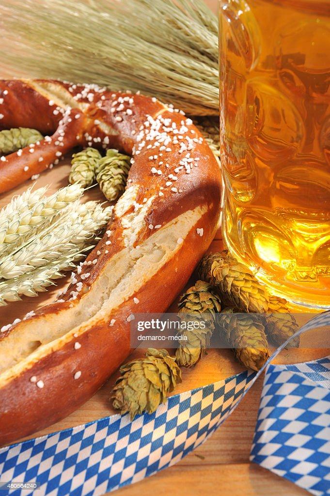 Bavarian Oktoberfest soft pretzel with beer : Stock Photo
