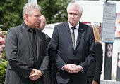 Bavarian Prime Minister Horst Seehofer and Major of Munich Dieter Reiter visit the site of a shooting at a fast food restaurant and the Olympia...