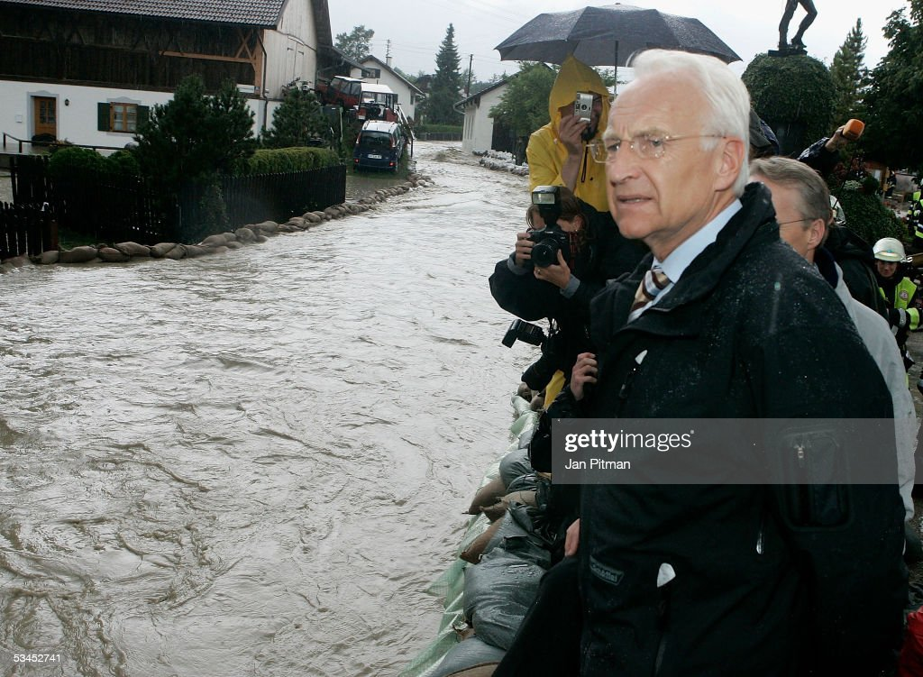 Bavarian State Governor Edmund Stoiber looks at a flooded street on August 23, 2005 in Eschenlohe, Germany. Heavy rainfall and floods in both Austria and Switzerland caused many of the rivers in southern Germany to flood. Half of Eschenlohe town has been evacuated and streets in the whole area are closed to traffic.