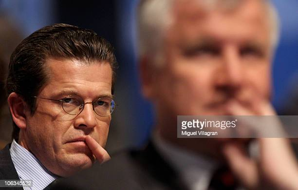 Bavarian state Governor Horst Seehofer and German Defence Minister KarlTheodor zu Guttenberg attend the CSU party convention at Messe Muenchen on...