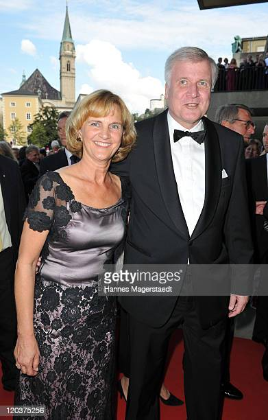 Bavarian state governor Horst Seehofer and his wife Karin attend the Premiere of Cosi Fan Tutte at the Haus fuer Mozart on August 5 2011 in Salzburg...