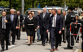 Bavarian state governor Horst Seehofer and members of the Bavarian state government arrive at the crime scene for a wreathlaying ceremony at OEZ...