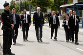Bavarian state governor Horst Seehofer attends the crime scene at OEZ shopping center the day after a shooting spree left nine victims dead on July...