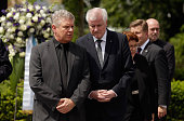 Bavarian state governor Horst Seehofer Munich's lord mayor Dieter Reiter and members of the Bavarian state government attend the crime scene for...
