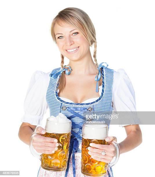 Bavarian Wiesn girl in dirndl with beer
