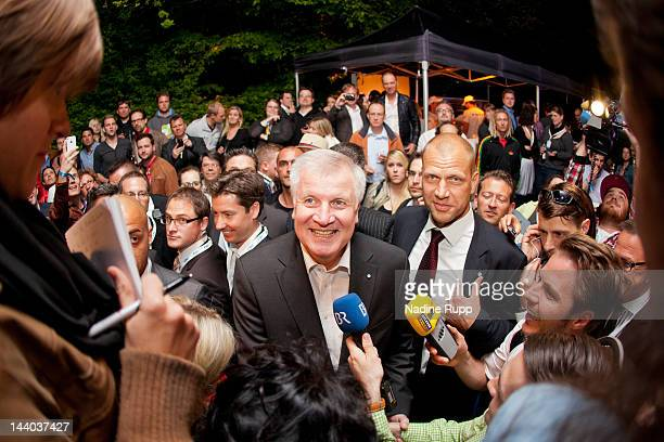 Bavaria's Premier Horst Seehofer talks to the guest during his facebookfan party at P1 club on May 8 2012 in Munich Germany
