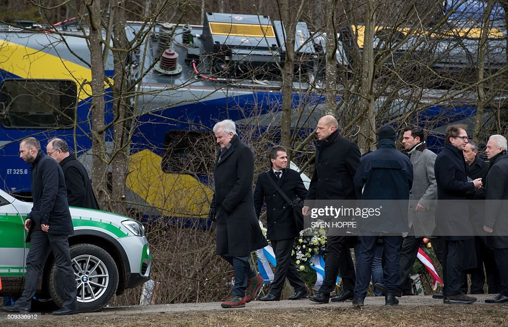 Bavaria's State Premier Horst Seehofer (3rd L) visits the site of a train accident near Bad Aibling, southern Germany, on February 10, 2016. Two Meridian commuter trains operated by Transdev on February 9, 2016 collided head-on near Bad Aibling, around 60 kilometres (40 miles) southeast of Munich, killing ten people and injuring around 80, police said. / AFP / dpa / Sven Hoppe / Germany OUT