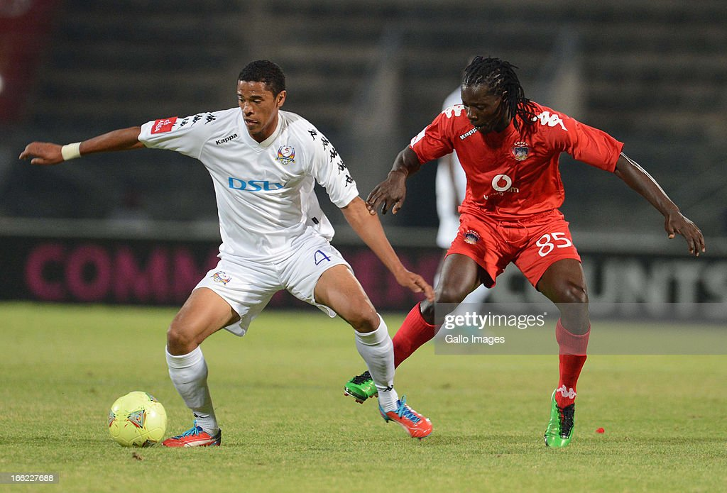 Baven Fransman of SuperSport and Benjani Mwaruwari of Chippa during the Absa Premiership match between SuperSport United and Chippa United from Lucas Moripe Stadium on April 10, 2013 in Pretoria, South Africa.