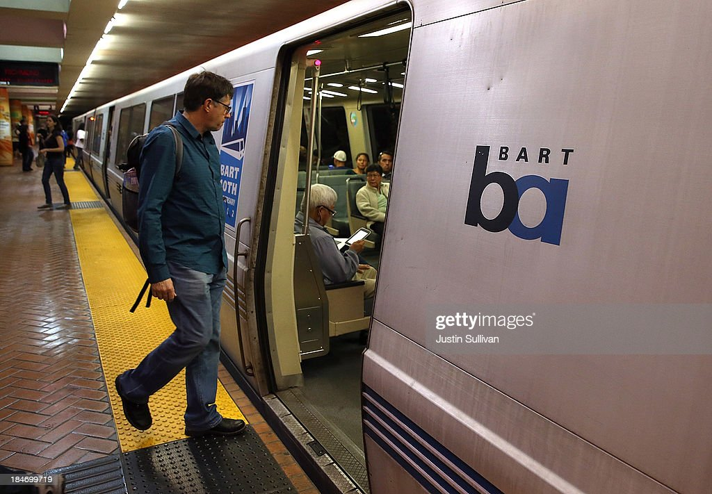 A Bay Area Rapid Transit (BART) passenger boards a train on October 15, 2013 in San Francisco, California. BART management and union leaders with Bay the Amalgamated Transit Union Local 1555 and the SEIU Local 1021 continue to negotiate a new contract for workers as the threat of a transit strike continues to loom over the heads of Bay Area commuters. BART, the nation's fifth-largest commuter rail system, carries nearly 400,000 passengers every weekday.