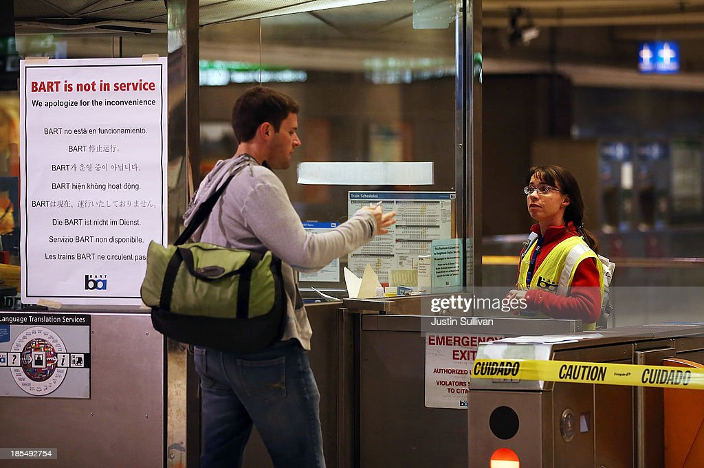 A Bay Area Rapid Transit (BART) worker helps a commuter at the Embarcadero station on October 21, 2013 in San Francisco, California. BART workers continue to strike after contract negotiations between BART management and the transit agency's two largest unions fell apart last week. Management and unions agreed on the financial specifics of the contract but differed on workplace safety rules. An estimated 400,000 commuters ride BART each day.