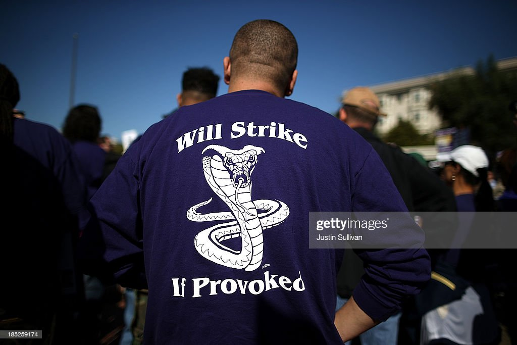 A Bay Area Rapid Transit (BART) worker wears a strike shirt during a rally in front of the Lake Merritt BART station on the first day of the BART strike on October 18, 2013 in Oakland, California. For the second time this year, BART workers have gone on strike after contract negotiations between BART management and the transit agency's two largest unions fell apart on Thursday afternoon. Management and unions agreed on the financial specifics of the contract but differed on workplace safety rules.
