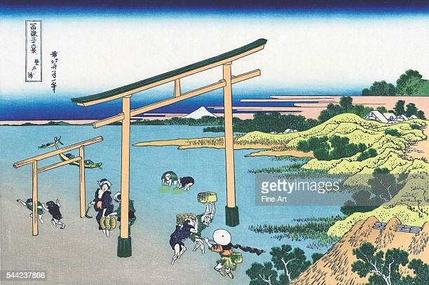 Bay of Noboto from the ukiyoe series '36 Views of Mt Fuji' Depicts shellfish gatherers and two torii gates Color woodblock print Circa 1830 Private...