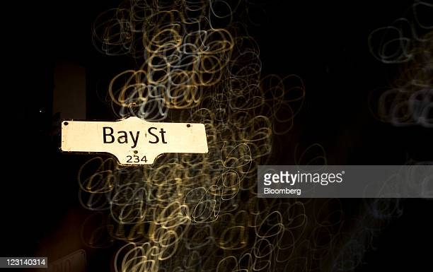A Bay Street sign stands in this long exposure photograph taken in Toronto Ontario Canada on Monday Aug 29 2011 Bay Street is the center of Toronto's...