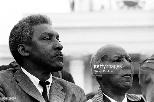 "Bayard Rustin and A Philip Randolph listen to Dr King deliver his ""How Long Not Long"" speech on the steps of the Alabama State Capitol in Montgomery..."