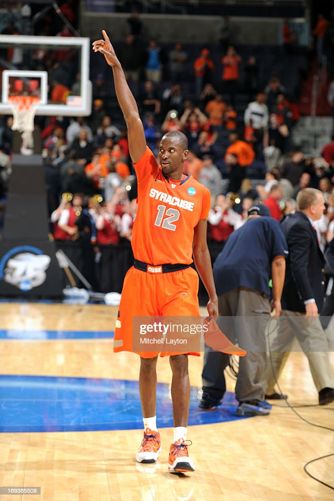 Baye Keita #12 of the Syracuse Orange celebrates a win after the East Regional Round of the 2013 NCAA Men's Basketball Tournament game against the Indiana Hoosiers at Verizon Center on March 28, 2013 in Washington, DC. The Orange won 61-50.