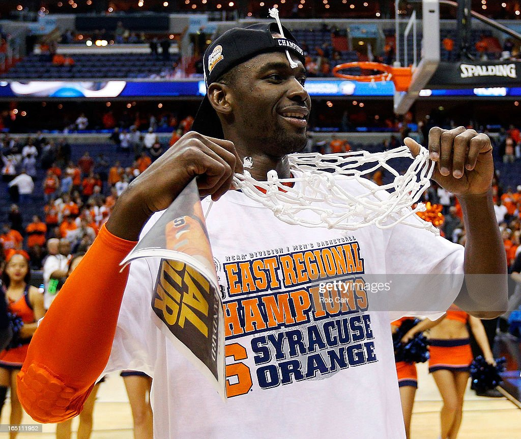 Baye Keita #12 of the Syracuse Orange celebrates after defeating the Marquette Golden Eagles to win the East Regional Round Final of the 2013 NCAA Men's Basketball Tournament at Verizon Center on March 30, 2013 in Washington, DC.