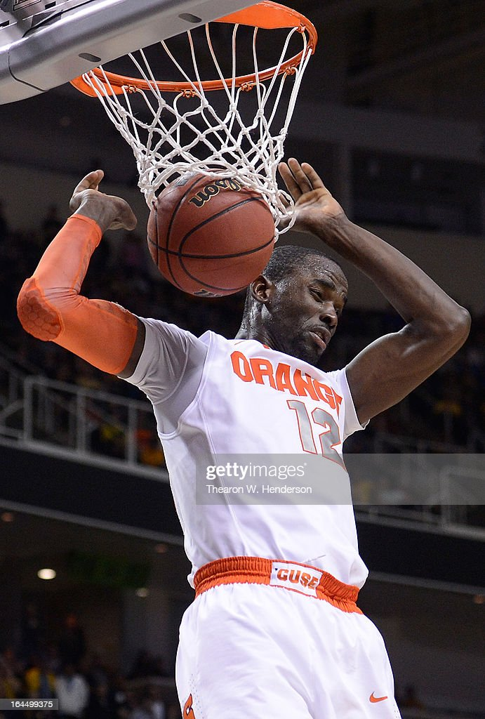 Baye Keita #12 of the Syracuse Orange dunks against the California Golden Bears in the second half during the third round of the 2013 NCAA Men's Basketball Tournament at HP Pavilion on March 23, 2013 in San Jose, California.