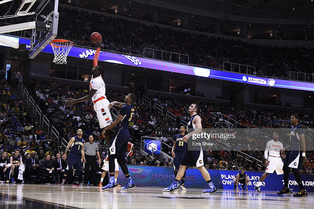 Baye Keita #12 of the Syracuse Orange goes up over Richard Solomon #35 of the California Golden Bears in the first half during the third round of the 2013 NCAA Men's Basketball Tournament at HP Pavilion on March 23, 2013 in San Jose, California.