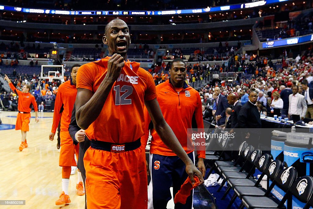 Baye Keita #12 of the Syracuse Orange reacts after defeating the Indiana Hoosiers during the East Regional Round of the 2013 NCAA Men's Basketball Tournament at Verizon Center on March 28, 2013 in Washington, DC.