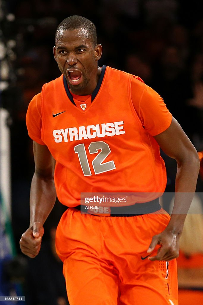 Baye Keita #12 of the Syracuse Orange reacts in overtime against the Georgetown Hoyas during the semifinals of the Big East Men's Basketball Tournament at Madison Square Garden on March 15, 2013 in New York City.