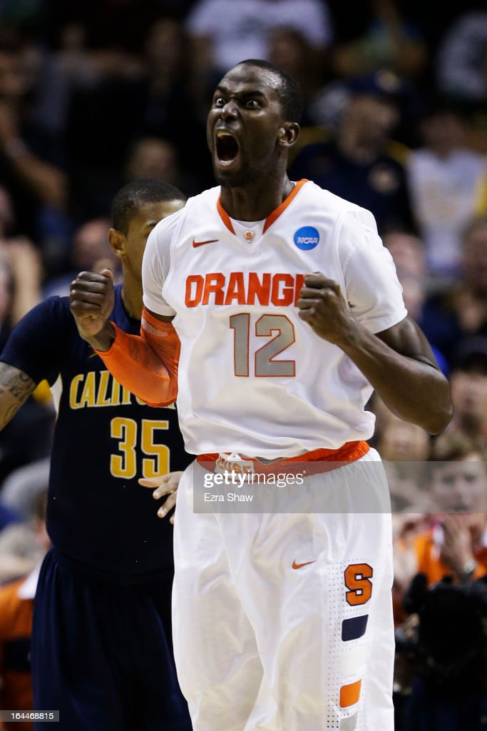 Baye Keita #12 of the Syracuse Orange reacts in the second half against the California Golden Bears during the third round of the 2013 NCAA Men's Basketball Tournament at HP Pavilion on March 23, 2013 in San Jose, California.