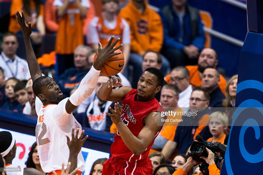 Baye Moussa Keita #12 of Syracuse Orange blocks a pass and controls the ball from Wayne Martin #45 of St Francis Terriers during the second half of a basketball game on November 18, 2013 at the Carrier Dome in Syracuse, New York. Syracuse wins 56-50.