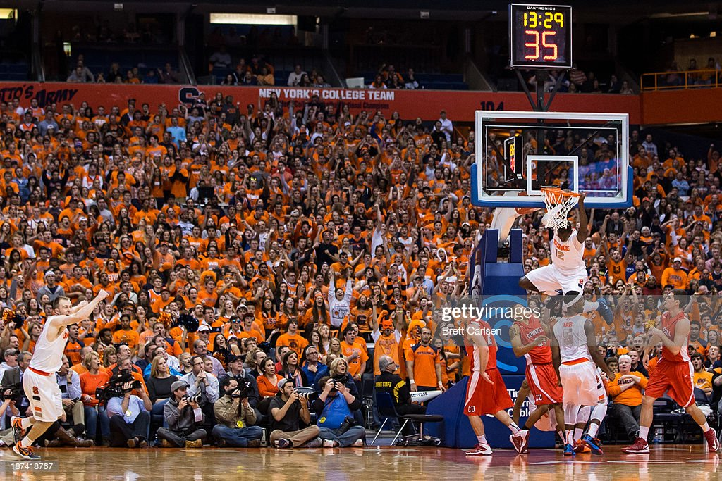 Baye Moussa Keita #12 of Syracuse Orange excites the crowd with a dunk in the second half of a basketball game against Cornell Big Red on November 8, 2013 at the Carrier Dome in Syracuse, New York.