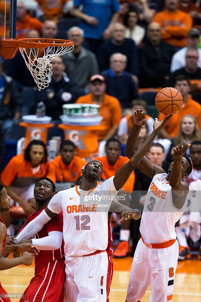 Baye Moussa Keita #12 of Syracuse Orange pulls in a rebound during the second half of a basketball game against St Francis Terriers on November 18, 2013 at the Carrier Dome in Syracuse, New York. Syracuse wins 56-50.