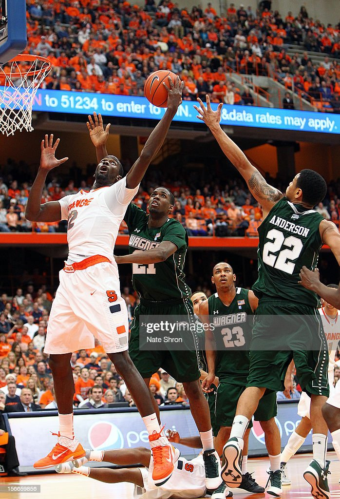 Baye Moussa Keita #12 of the Syracuse Orange puts the ball up to the basket against Orlando Parker #21, Jonathon Williams #23 and Dwaun Anderson #22 of the Wagner Seahawks during the game at the Carrier Dome on November 18, 2012 in Syracuse, New York.