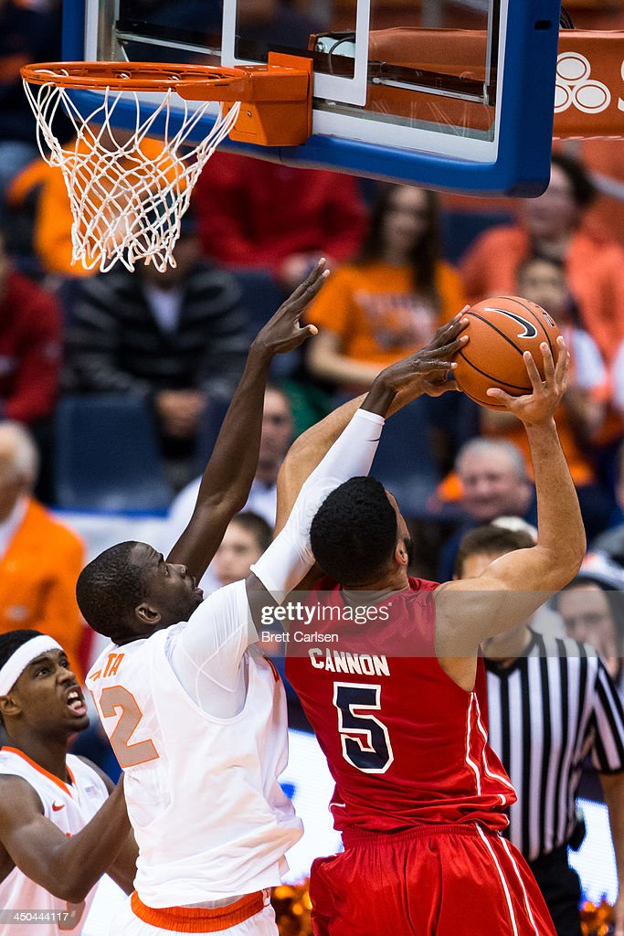 Baye Moussa Keita #12 Syracuse Orange fouls Jalen Cannon #5 of St Francis Terriers as they go up at the basket during the second half on November 18, 2013 at the Carrier Dome in Syracuse, New York. Syracuse wins 56-50.