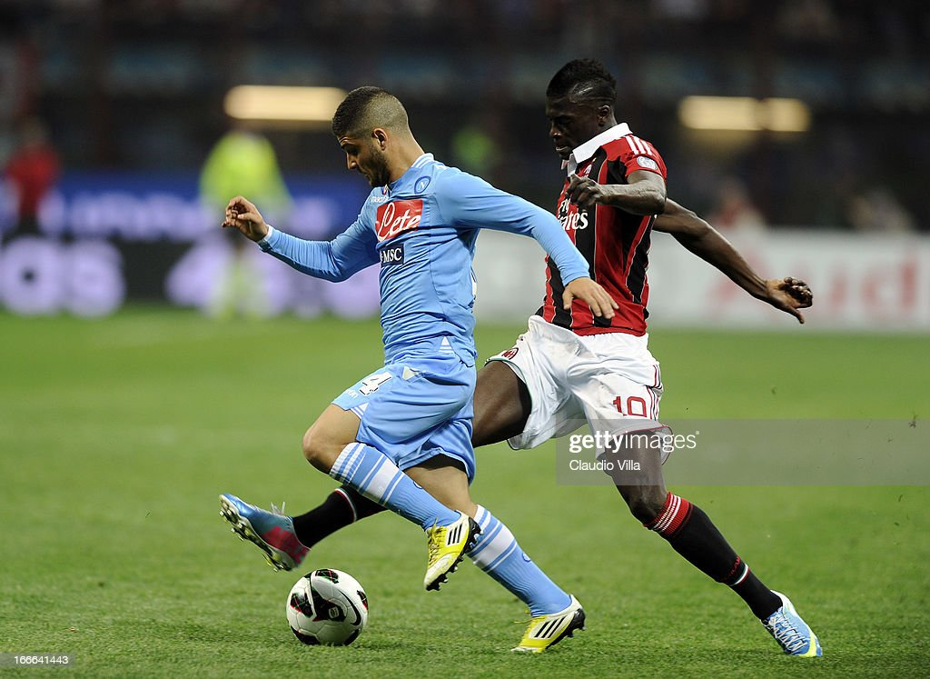 M'Baye Niang of AC Milan and Lorenzo Insigne of SSC Napoli (L) compete for the ball during the Serie A match between AC Milan and SSC Napoli at San Siro Stadium on April 14, 2013 in Milan, Italy.
