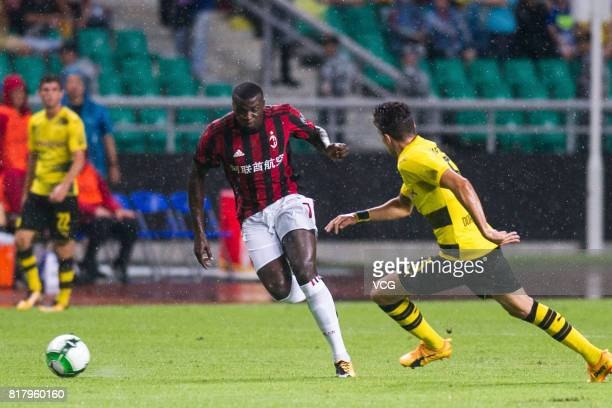 Baye Niang of AC Milan and Marc Bartra of Borussia Dortmund compete for the ball during the 2017 International Champions Cup China between AC Milan...