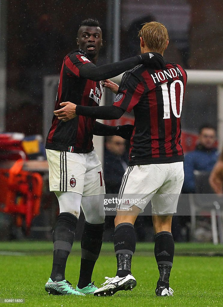 M Baye Niang of AC Milan celebrates his goal with his team-mate <a gi-track='captionPersonalityLinkClicked' href=/galleries/search?phrase=Keisuke+Honda&family=editorial&specificpeople=2333022 ng-click='$event.stopPropagation()'>Keisuke Honda</a> during the Serie A match between AC Milan and Udinese Calcio at Stadio Giuseppe Meazza on February 7, 2016 in Milan, Italy.