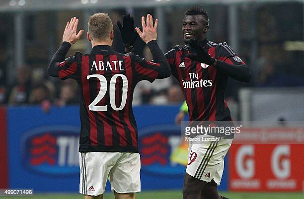 Baye Niang of AC Milan celebrates his second goal with his teammate Ignazio Abate during the Serie A match between AC Milan and UC Sampdoria at...