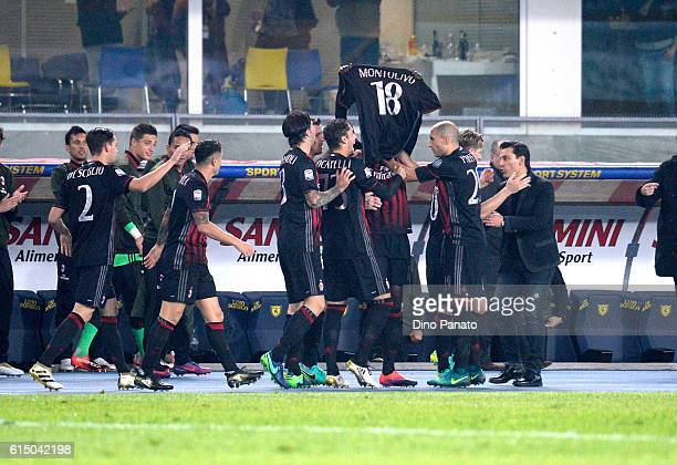 Baye Niang of AC Milan celebrates with the jersey of Montolivo after scoring his team's second goal during the Serie A match between AC Chievo Verona...